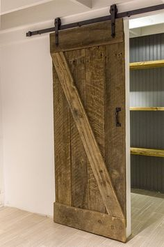 $20 barn wood + $90 hardware kit = authentic barn door! Tutorial inside.