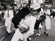 August 14, 1945 ~ Americans celebrate Japan's surrender to the United States. This iconic picture by Alfred Eisenstaedt was taken on that day in Times Square <3