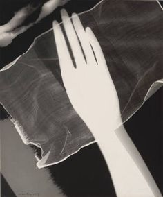 """Rayograph. (hand, scarf, brush and cotton)  Man Ray (American, 1890–1976)    1927. Gelatin silver print (photogram), 11 7/8 x 9 7/8"""" (30.2 x 25.1 cm). Gift of James Thrall Soby. © 2013 Man Ray Trust / Artists Rights Society (ARS), New York / ADAGP, Paris ."""