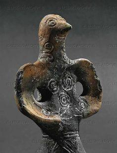 """"""" Head of the bird-like woman from the bird-drawn wagon.  From Dupljaja, location Grad, Serbia.  Terracotta (15th BCE)"""