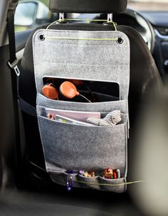 DIY Cars Hacks : Illustration Description A felt hanging organiser from IKEA tied to the back of a car seat with space for markers, coloring books and a tablet for kids as a diy car organiser. -Read More –