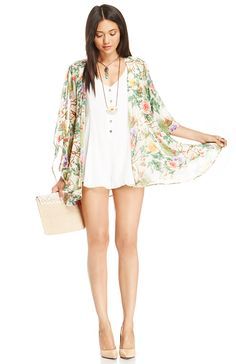 Play around in a white romper and floral kimono for a boho-insired look that perfectly captures the essence of the free-flowing American Gypset.