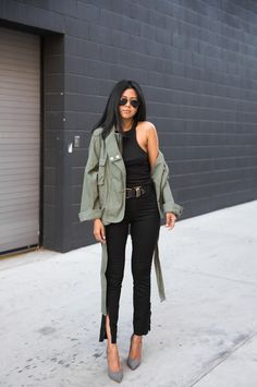 Top: walk in wonderland blogger belt black pants army green jacket black grey heels slit pants