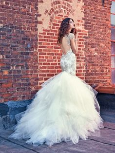 Just wow, Felicity!  Limited Edition - 100 pieces! Felicity is an entirely hand embroidered and hand sewn trumpet gown. It is dramatic in volume, fabric, color and beading. It has an unusual neckline which combines a very deep plunging V-shape with a high