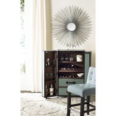 The Sunburst mirror with its delicate wire spokes radiating from a central disc will glow night and day to reflect your room's lighting.