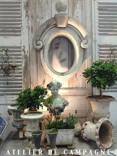 Atelier de Campagne architectural salvage urns topiaries shutters