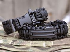 RE Factor Tactical Survival Band: paracord, fishing line, hook, whistle, flint and can opener //