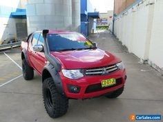 2010-mitsubishi-triton-mn-my11-glx-r-red-manual-5sp-m-4d-utility-16438-2.jpg (800×600)