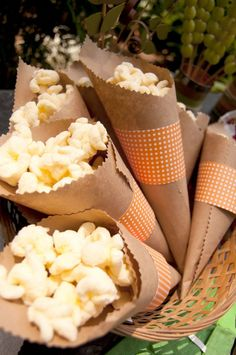 popcorn cones; use the scoop and jar and have these available to scoop the snack in. Incredibly cheap