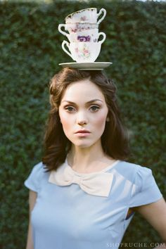 Vintage tea cups and a whimsical bow top. #shopruche #ruche