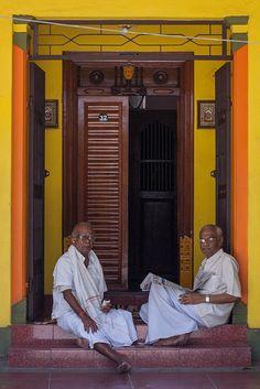 Men sitting outside Vysial Street house in Pondicherry