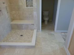 Travertine bathroom.