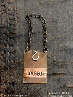 The Bourbon Bottle Tag Collection The Riveted Series by Sycamore Hill, $44.00 Step Away From My Bourbon™ Bottle Tag Copyright 2012 Artist Kelly Galanos KK designs layered copper brass metals hand stamped handmade with vintage equestrian horse horse racing charm