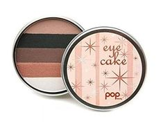 Pop Beauty Eye Cake - Naked Blue Eyes. Pop Beauty Eye Cake - Naked Blue Eyes. 5 co-ordinating shades of pressed powder eye shadow in 1 compact palette. Shades: Snow-White, Metallic Bronze Shimmer, Chocolate, Matte Black, & Warm Nude. Color: Naked Blue Eyes. Full Size - Manufacturer Sealed.