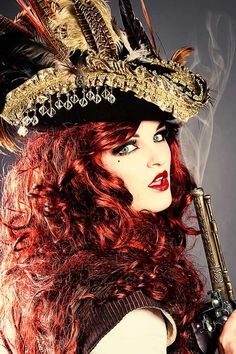 Steampunk: A Steampunk beauty in a top hat and armed with a gun. Pirate Woman, Pirate Life, Lady Pirate, Death Metal, Cyberpunk, Rockabilly, Steam Girl, Steam Punk, Grunge