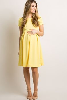 A basic solid hued maternity dress featuring a rounded neckline, pleated skirt and short sleeves. Yellow Maternity Dress, Maternity Dresses Summer, Maternity Skirt, Cute Maternity Outfits, Stylish Maternity, Maternity Wear, Maternity Fashion, Dresses For Pregnant Women, Pregnant Wedding Dress
