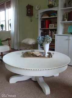 Coffee table makeover from Pink Postcard - after - painted white round coffee table with nail head trim accent Refurbished Furniture, Repurposed Furniture, Furniture Makeover, Painted Furniture, Coffee Table Makeover, Diy Coffee Table, Round Coffee Table, Round Tables, Furniture Projects