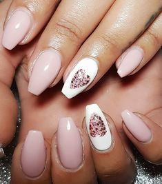 Pink gel valentine nails with handpainted glitter hearts