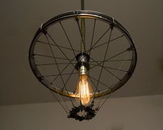 Silver Bike Wheel Cage Chandelier by HybridMoments on Etsy, $285.00