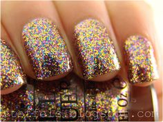 OPI Sparkle-icious, three coats. Very dense. Gold, blue and fuchsia