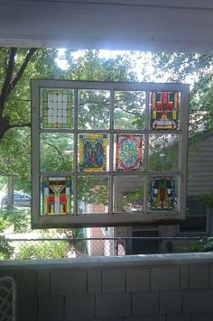 """We """"rescued"""" a bunch of wood-frame windows from my sister's remodel and have thought of doing something like this on our porch. """"Stained Glass"""" Window - JUNKMARKET Style"""