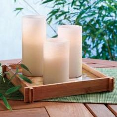 "BAMBOO TRAY, Present a pillar garden or food and beverages with exotic flair.  Slatted bamboo tray offers clean, modern lines, a removable glass insert and convenient handle cutouts. 9"" sq. CLEARANCE $10"