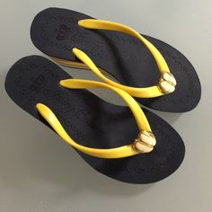 New Juicy Couture wedge Sandals sz 5 Hard to find Juicy Couture Wedge sandals in navy, white and yellow. Gold metal Apple charm detail. Juicy Couture Shoes Sandals
