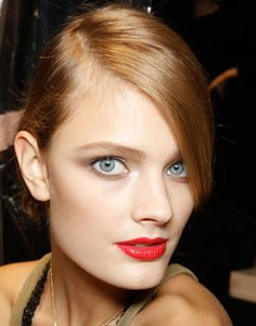 Lipstick's most iconic color was reinvented this season, proving that there are endless ways to wear a dramatic red.