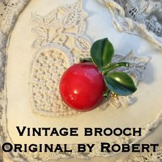 Vintage Original By ROBERT Apple Cherry Brooch Pin This is a beautiful vintage Original By ROBERT goldtone red green enamel apple cherry pin brooch. The enamel is in great condition being its age with little wear to back? See pic. Such a colorful brooch that ready to wear and /or add to your brooch collection! ❣Thanks for looking! Have a blessed day! I ship out same day as purchase! But with confidence with over 150 5 star feedback! Ask any questions before purchasing! Please make REASONABLE…
