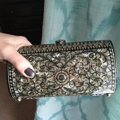 Vintage Clutch Gorgeous mother of pearl hand-held clutch. Opens at the top and has beautiful velvet lining. In mint condition! ✨ Vintage Bags Clutches & Wristlets