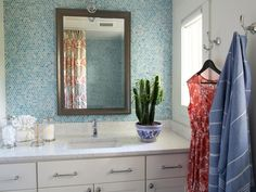 The HGTV Dream Home 2016 is a remodeled beach house in Florida with hot tropical colors, calming blue-grey living rm and kitchen & beautifully designed. Hgtv Dream Home 2016, Hgtv Dream Homes, Blue Penny Tile, Bathroom Pictures, Bathroom Ideas, Ikea Bathroom, Boho Bathroom, Bath Ideas, Guest Bathrooms