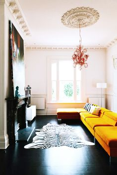 yellow sofa and rust chandelier
