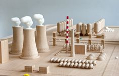 Maykel Roovers contrasts the harshness of industrial architecture with the illusory world of children's toys.
