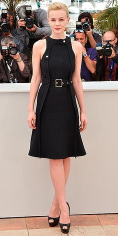 CAREY MULLIGAN If this Chloé dress with its chunky belt and high waistline doesnt seem like something Daisy Buchanan would choose, thats because Carey is wearing it at a photo call to promote her other big movie, Inside Llewyn Davis.