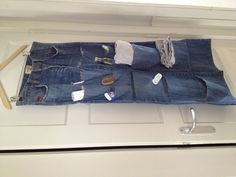 DIY Handy bathroom vacation organizer fast-easy-very cheap-recycling  Tools: Sewing machine Seam ripper/scissors  You need: Old jeans Sewing thread Hanger