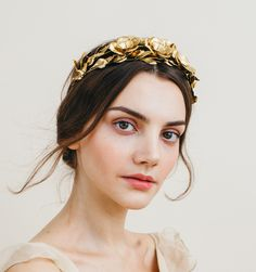 A circlet of golden leaves and three large golden flowers make up the Rowena Circlet. An ornate headpiece, each leaf is wired by hand for the most naturalistic effect. Wear as a fashion statement with casual attire, or to complete your outfit for a formal affair (or even your wedding!). This headband is finished with ribbon ties at back. Ethically made by hand in New York City.
