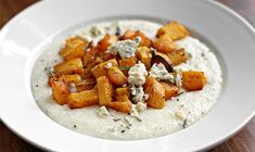 Parmesan Grits with Roasted Butternut Squash and Blue Cheese | Ezra Pound Cake. Grits get upgraded in this vegetarian Southern meal.