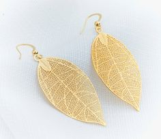 Check out this item in my Etsy shop https://www.etsy.com/il-en/listing/184843115/big-earrings-gold-earrings-gold-leaf