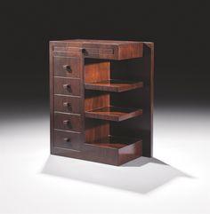 Pierre Chareau (1883-1950) Table de chevet, vers 1925 En palissandre de Rio, de forme rectangulaire, le plateau supérieur muni d'une tablette retractable en ceinture, surmontant à gauche une série de cinq tiroirs en chêne plaqué de noyer et à droite deux étagères, le montant arrière droit débordant, les boutons de tirage cubiques Hauteur : 69,5 cm (27 3/8 in.) ; Largeur : 56 cm (22 in.) ; Profondeur : 30 cm Art Deco Furniture, French Furniture, Unique Furniture, Furniture Making, Furniture Design, Art Decor, Decoration, Home Decor, Mission Style Furniture