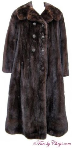 Ranch Mink Coat #RM730. $600.00; Very Good Condition; Size range: 8 - 12 Petite. (Bargain Basement Fur). This is a beautiful genuine natural ranch mink fur coat in a very petite size. It has a Lewitz Furs label and features a large notched collar, straight sleeves and a horizontal band at the bottom hem. It closes with black rhinestone clustered buttons (a few of the rhinestones are missing). Ranch mink is a classic and this ranch mink coat will keep you warm and stylish at the same time!