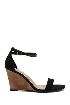 0b2d599548 DetailsA pair of faux suede wedges featuring an open toe and an adjustable  ankle strap.