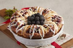 Add a twist to an all time favorite! Blackberries and pecans make the old fashioned cinnamon roll that much better!