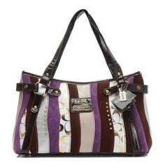 Bold stripes add a graphic edge to this sophisticated bag, compact and surprisingly chic, in elegant luxe leather trim and an assortment of useful pockets inside.