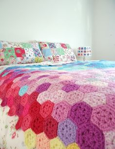Pretty crocheted afghan blanket on a bed
