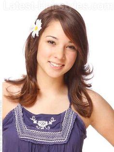 brunette-little-girl-flower-in-hair-view-2