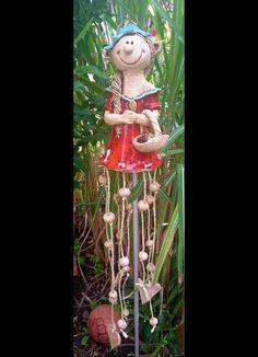 http://de.dawanda.com/product/84670111-elfe-gnom-troll-windspiel-gartenkeramik