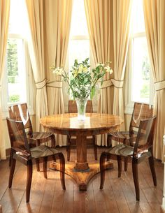 Love this combination--perfect draperies for this dining furniture.