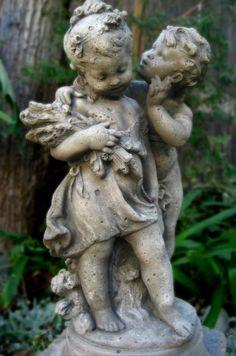 """French cherubs, based on Auguste Moreau's """"The Secret."""""""