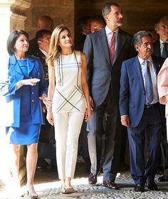 Queen Letizia wore Massimo Dutti Trousers and Uterque gold Pumps. Roberto Verino blouse, Hugo Boss