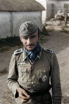 A candid portrait of a Heer's Feldwebel (Sergeant) photographed somewhere in the Army South's sector, 1943/44.  He wears a M40 Summer field tunic (with M36 bottle green collar) which with use would quickly fade to one of a myriad of light greyish khaki tones.  This veteran was awarded the Iron Cross 2nd Class and the Eastern Front Medal (known among German soldiers as the 'Frozen Meat' Medal). He also sports the Infantry Assault Badge (silver) and the Wound Badge in Black.
